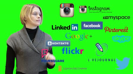 sosyal : SAINT-PETERSBURG, RUSSIA - CIRCA NOVEMBER, 2014: Young Caucasian woman touches screen with social media icons as twitter, facebook, linkedin, instagram. Follow us text, isolated green screen Stok Video