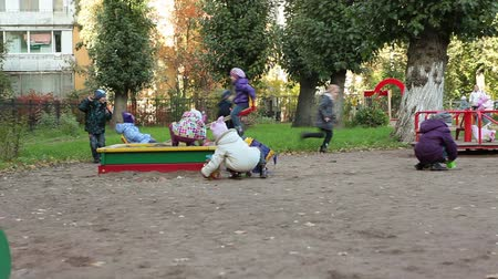 çocuk : Nursery school group of children playing on playgroung at autumn day