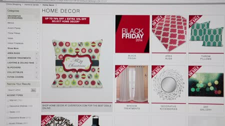 e ticaret : MOSCOW, RUSSIA - CIRCA DEC, 2014: Black friday deals are in Overstock.com store.   Overstock.com is a technology-based retail company offering customers a wide variety of high-quality products