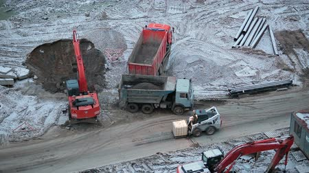 projects : Construction site with machinery: lorries, excavator, loader.