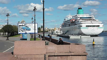 lieutenant : Panorama Lieutenant Schmidt Embankment with moored cruise liners and roadway with people Stock Footage