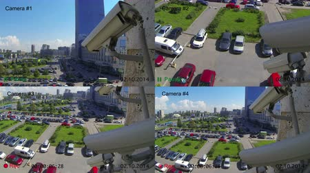 безопасность : Video surveillance cameras on the wall, view from security console, four color screens in one, recording