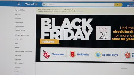 walmart : MOSCOW, RUSSIA - CIRCA DEC, 2014: Black friday shopping page is in Walmart.com store. Walmart is an American multinational retail corporation with chain of discount and warehouse stores Stock Footage