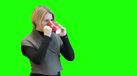 bögre : Happy laughing Caucasian woman standing on green screen with red tea mug