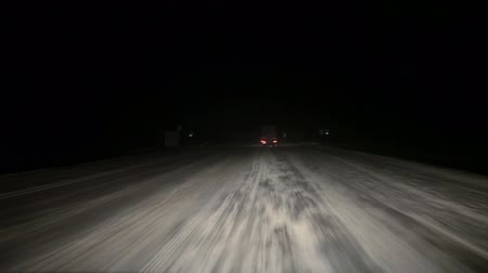 truck stop : Truck overtaking on winter night snowy road. View in headlights. Karelia, Kola route, Russia