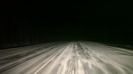 night : Car driving through the night on winter road. Visibility limited by headlight