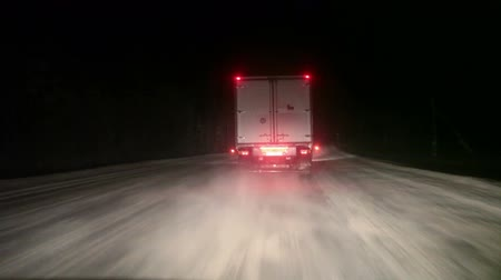 truck stop : Night truck overtaking on winter snowy road. Karelia, the Kola route, Russia