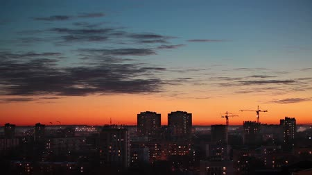 sunset city : Beauty sunset over city, cityline with blue and orange sky, Saint-Petersburg, Russia. Loop Stock Footage