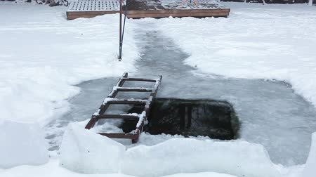 epiphany : Ice-hole for cold water dipping on the winter lake, nobody Stock Footage