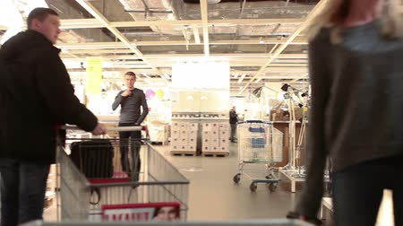 self storage : SAINT-PETERSBURG, RUSSIA - CIRCA JAN, 2015: People walk in Ikea marketplace. Ikea multinational group is the worlds largest furniture retailer. Russian store Stock Footage