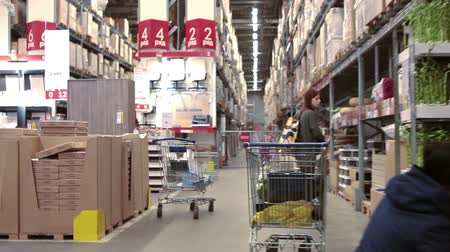 áruk : SAINT-PETERSBURG, RUSSIA - CIRCA JAN, 2015: Customers choose furniture accessories in Ikea marketplace. Ikea multinational group is the worlds largest furniture retailer. Russian store