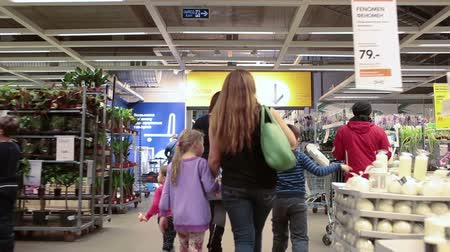self storage : SAINT-PETERSBURG, RUSSIA - CIRCA JAN, 2015: People with children walk in Ikea marketplace. Ikea multinational group is the worlds largest furniture retailer. Russian store