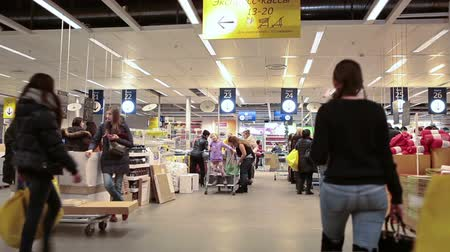 kuyruk : SAINT-PETERSBURG, RUSSIA - CIRCA JAN, 2015: People stan to cash registers in warehouse area. Ikea multinational group is the worlds largest furniture retailer. Russian store