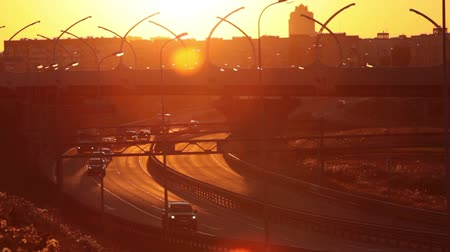 high speed road : Sunset over western High Speed Diameter elevated route and cars driving on turning to highway in Saint-Petersburg, Russia Stock Footage
