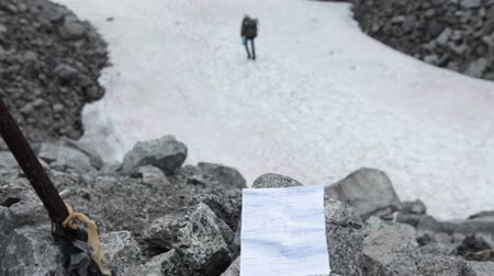 trail marker : Hand written paper note with contact information of group held mountain pass. Climber, rescuer goes further. Khibiny massif, Kolsky Peninsula, Russia