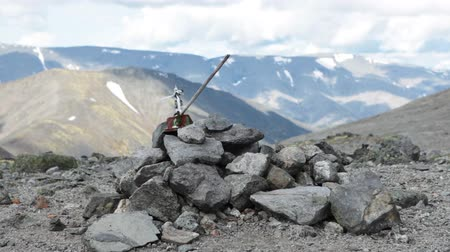 trail marker : Man made cairn as trail marker on the South Rischorr pass with old kettle on the stick, Khibins mountains, Russia.