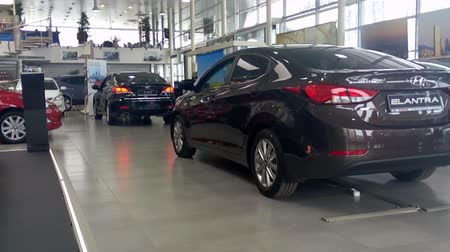 revendedor : ST. PETERSBURG, RUSSIA - CIRCA APR, 2015: Hyundai Elantra and other cars are in auto dealership showroom. The Rolf Lahta is a official dealer of Hyundai Motors