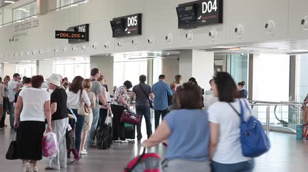 cancellation : ST. PETERSBURG, RUSSIA - CIRCA JUL, 2015: Passengers stand in queue at departure lounge for aircraft boarding. Interior of new building of Pulkovo International airport Stock Footage