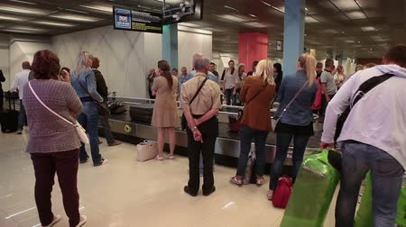 reclaim : YEKATERINBURG, RUSSIA - CIRCA JUL, 2015: Arriving passengers claim checked-in baggage after disembarking from an airline flight. Koltsovo Airport is the international airport in Sverdlovsk Oblast