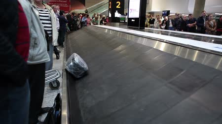 reclaim : ST. PETERSBURG, RUSSIA - CIRCA JUL, 2015: Empty baggage conveyor system. Passengers wait checked-in luggage delivery. Baggage reclaim area. The Pulkovo is an International airport in Russia