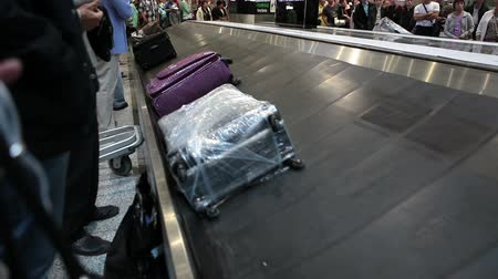 reclaim : ST. PETERSBURG, RUSSIA - CIRCA JUL, 2015: Suits and bags are on baggage carousels. Passengers claim checked-in luggage. The Pulkovo is an International airport in Russia Stock Footage