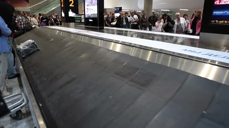 reclaim : ST. PETERSBURG, RUSSIA - CIRCA JUL, 2015: Several bags are on empty baggage carousels. Passengers waiting checked-in luggage. Baggage reclaim area. The Pulkovo is an International airport in Russia