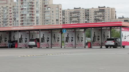 lavagem : SAINT-PETERSBURG, RUSSIA - CIRCA JUN, 2015: City all-day self-serve carwash is in the parking lot of shopping center.  Self-service is a simple and automated type of car wash