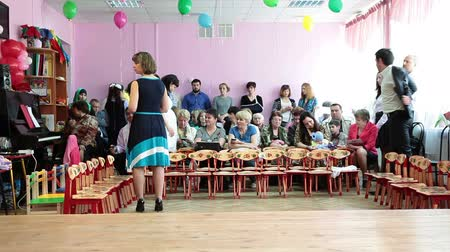 Çocuk bakımı : ST. PETERSBURG, RUSSIA - CIRCA MAY, 2015: Parents spectators sit in hall ready for performance view, theater is in kindergarten in Russia