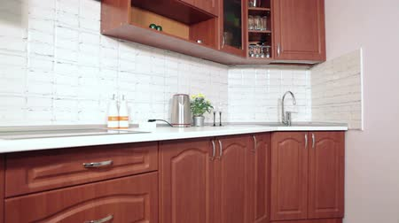 mutfak malzemesi : Interior of brown and white domestic kitchen, nobody Stok Video