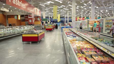 corredor : HURGHADA, EGYPT - CIRCA NOV, 2015: Frozen foods are in the refrigerators in a trading area of the Spinneys supermarket in the Senzo Shopping Mall. The Spinneys Group Limited has three grocery stores in Egypt