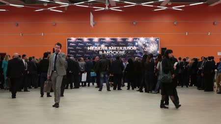 demirli : MOSCOW, RUSSIA-CIRCA DEC, 2015: Crowd of visitors come to scene for opening ceremony the Metal-Expo 2015. Metal and Steel Market, the 21st International Industrial Exhibition was in the VDNKH