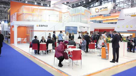 demirli : MOSCOW, RUSSIA-CIRCA DEC, 2015: Members and guests meet on the exhibition stand of Evraz group. The Metal-Expo 2015. Metal and Steel Market, the 21st International Industrial Exhibition was in the VDNKH Stok Video