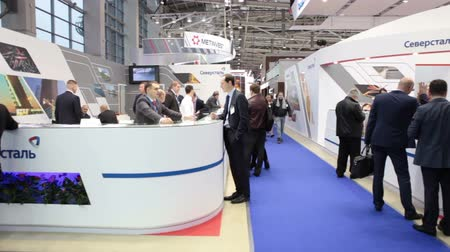 demirli : MOSCOW, RUSSIA-CIRCA DEC, 2015: Visitors of exhibition are near the information desk of Severstal Metallurgical Company on the Metal-Expo 2015. Metal and Steel Market, the 21st International Industrial Exhibition was in the All-Russia Exhibition Center