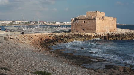ciprus : The Paphos Castle on Mediterranean seashore in Cyprus island, waves breaking shore. Paphos city Stock mozgókép