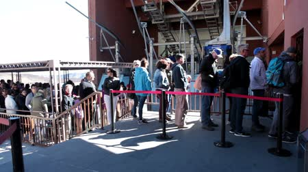 kuyruk : TEIDE, TENERIFE - CIRCA JAN, 2016: Visitors stand long queue to ticket office for travel to the top at Pico del Teide. Outside view at lower station of Teleferico cable car.
