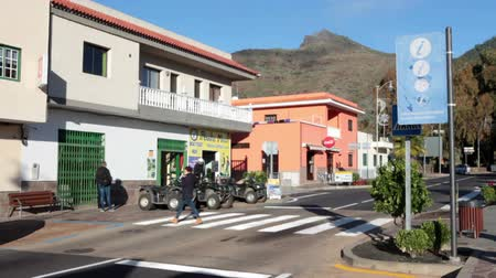 quad bike : SANTIAGO DEL TEIDE, TENERIFE, SPAIN - CIRCA JAN, 2016: Road crossing in center of town. Turn to the route TF-436 to Masca village from TF-82. Santiago del Teide is a town in the western part of the island