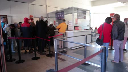 kuyruk : TEIDE, TENERIFE - CIRCA JAN, 2016: Visitors stand long queue to ticket office for travel to the top at Pico del Teide. Inside view at foyer of lower station of Teleferico cable car.
