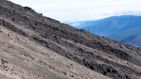 hardened lava : View from the cable car at Teide volcano slope during lifting up. Volcanic shapes. Tenerife, Spain Stock Footage