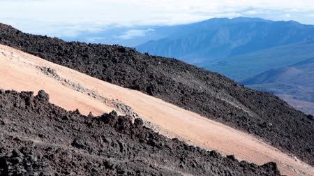 hardened lava : Hardened lava flows are on the Teide volcano slope. View from lifting up cable cabin. Tenerife, Spain