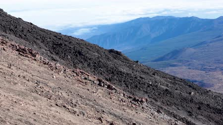 hardened lava : Igneous rocks of Teide volcano with hardened lava flows. View from lifting up cable car. Tenerife, Spain Stock Footage