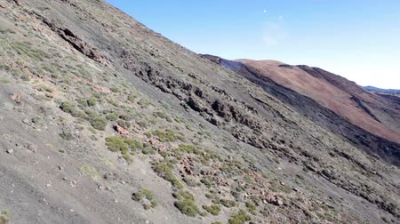hardened lava : View at the Teide volcanic steep slope during cable car lifting at the top. Tenerife, Canaries, Spain
