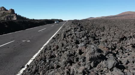 hardened lava : TENERIFE, SPAIN - CIRCA JAN, 2016: Lifeless fields of lava pebbles are on the curbs of route TF-38. National park Teno is in central part of Tenerife Island, Canary, Spain