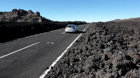 hardened lava : TENERIFE, SPAIN - CIRCA JAN, 2016: A lot of solidified lava pebbles are on the curbs of route TF-21. National park Teno is in central part of Tenerife, Canary islands, Spain