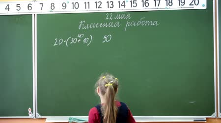 мел : Russian young student decides mathematics on the school blackboard in the classroom. School is in Russia Стоковые видеозаписи