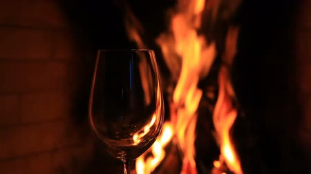 log cabin : Empty glass against the fire in the fireplace