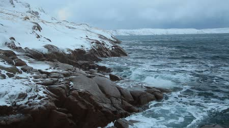 chukchi : Snowfall over the stormy sea in the north