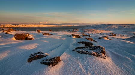 chukchi : Sunset on the snow-covered shore of the Barents Sea