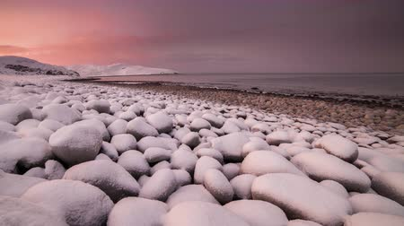 chukchi : Sunset on the snow-covered beach of the Barents Sea Stock Footage