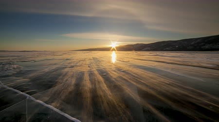 frozen lake : Winter Baikal. Strong wind on the ice, drifting snow.