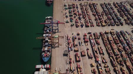 container terminal : Industrial Cargo area with container ship in dock at port, Aerial view Stock Footage